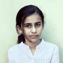 Neda Ibrahim (10) har bodd i ni år på asylmottak. Foto:Trine Poppe ©